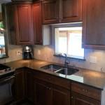 Kitchen,_Cherry_cabinets_with_quartz_countertops_fs