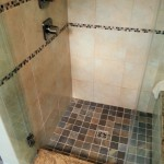 Shower,_Custom_shower_with_contrasting_tile_and_granite_threshold_and_bench_fs